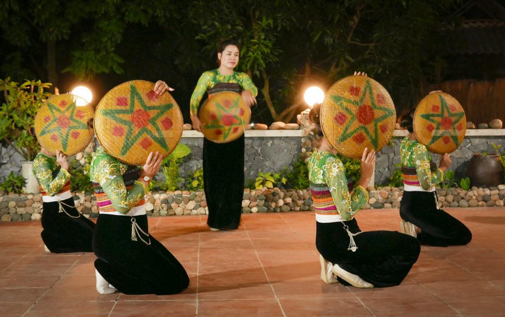 folk dance by Thai women Mai Chau Vietnam travel